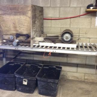 soil hopper and presser wheel